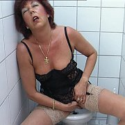 Granny Masturbates In Public Bathroom