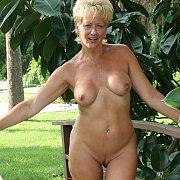 Swinging Mature In Backyard