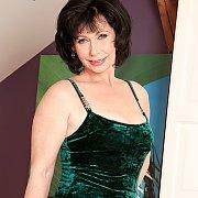 Mature Lady Strips Off Green Velvet Dress