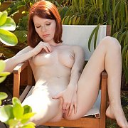 Freckled Face Redhead Fingering On The Patio