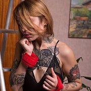 Tattooed Gal In Lingerie And Handcuffs