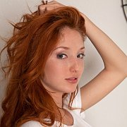 Pretty Redhead Girl With Light Freckles