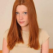 Teasing Creamy Skinned Freckled Red Hair Woman