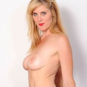 Blonde Freckled Face Milf On The Red Couch
