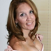 Pretty Milf With Freckles Teasing In Underwear
