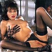 Latina In Stockings In The Bedroom