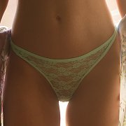 Lace Panties On An Arousing Brunette
