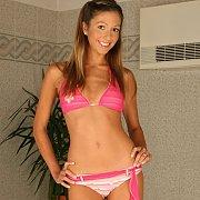 Slender bikini babe gets wet