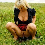Peeing In A Grass Field