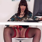 Office Milf Upskirts Behind Her Desk