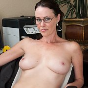 Milf With Freckles Naked In The Office