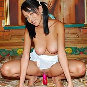 Pigtails Latin Chick On The Bed Toying