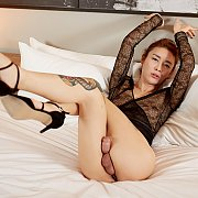 Stripteasing Japanese Shemale On The Bed
