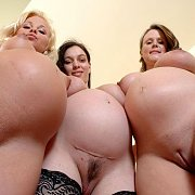 Upward View Of Three Pregnant Nudes