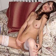 Masturbating Brunette In White Stockings