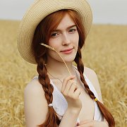Braided Pigtails Redhead In A Field