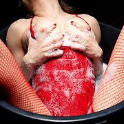 Wet Lingerie And Fishnets Lady In A Bucket