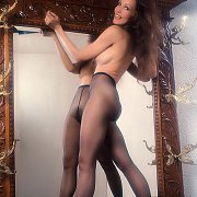 Lovely Legs Brunette Woman In Nylons Topless