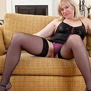 Blonde Milf Strips In Her Stockings