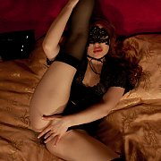 Masked Redhead In Stockings Masturbates