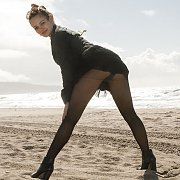 Nylons Teaser On The Beach In Her Heels