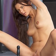 Sensual brunette enjoys toy