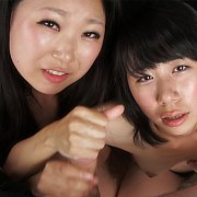 Two Japanese Gals Stroke A Man