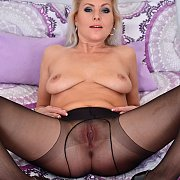 Spread Legs Pantyhose Milf On The Bed