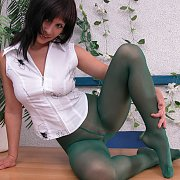Green Nylons Amateur Lady Posing On the Desk