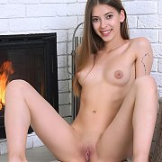 Puffy Nipples Brunette By The Fireplace