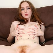 Redhead With Pale Flesh And Freckles