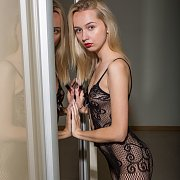 Slim Blonde Teen Teasing In Bodystocking