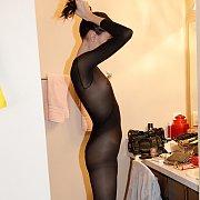 Slim Brunette Teases In Bodysuit