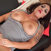 Busty Milf With Tats In Stockings