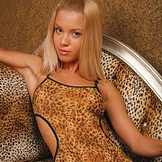 Cute Blonde Teen Strips Leopard Teddy
