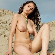 Naked Busty Teen In The Sand