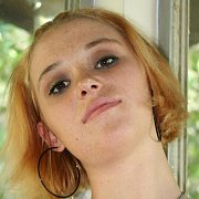 Redheaded Freckled Gal Showing Her Shaved Pink