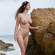Busty Brunette Erotic Model At The Beach Nude