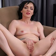 Creamy Flesh Raven Milf Rubbing On The Couch