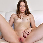 Masturbating Petite Brunette On The Couch