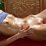 Slim Gal Rubs In Baby Oil Outside