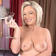 Mature Busty Lady Strips With A Martini