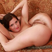 Petite Brunette Spreads Unshaved Pussy