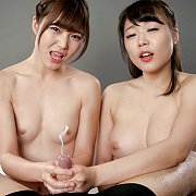 Two Asian Give A Handjob Together