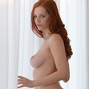 Stunning Red Haired Nude Model By The Window