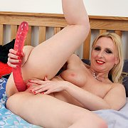 Blonde Milf Uses A Large Sex Toy
