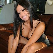 Arousing Teen Latina Strips On Couch