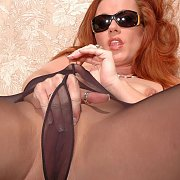Redhead Fingers In Pantyhose On The Patio