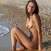 Naked On A Rocky Shore
