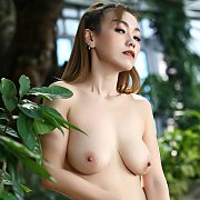 Asian Strips Naked By Bushes